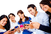Mensajes de texto en sus teléfonos celulares — Foto de Stock