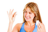 Woman taking a pill — Stock Photo