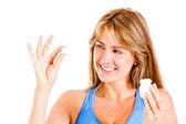 Femme de prendre une pilule — Photo