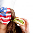 American woman eating hamburger — Stock Photo #10505808