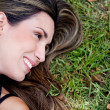 Woman lying outdoors — Stock Photo