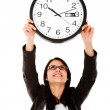Stock Photo: Business woman hanging a clock