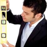Architect with level instrument — Stock Photo