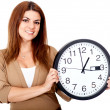 Woman holding a clock — Stockfoto