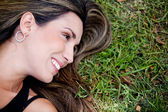 Woman lying outdoors — Stock Photo