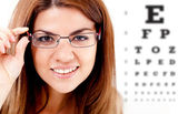 Woman taking an eye vision test — Stok fotoğraf
