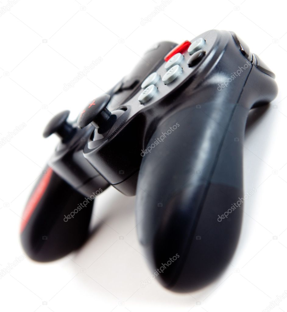 Black video game controller - isolated over a white background  Stock Photo #10589093