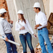 Architects at construction site — Stock Photo #10596467
