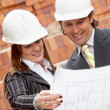 Architects looking at blueprints — Stock Photo #10596543