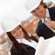 Architects at construction site — Stock Photo #10596861