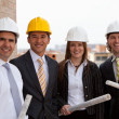 Architects at construction site — Stock Photo #10597135