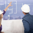 Stock Photo: Architects looking at blueprints