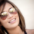 Woman wearing sunglasses — Stock Photo #10597282