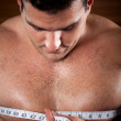 Man measuring his chest — Stock Photo
