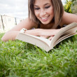 Woman reading outdoors — Stock Photo #10597438