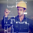 Construction worker sketching blueprints — Stock Photo #10597711