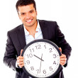 Business man holding a clock - Stock Photo