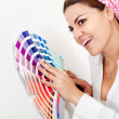 Stock Photo: Woman decorating her house