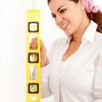 Woman holding level instrument — Stock Photo