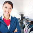 Stock Photo: Flight attendant in airplane