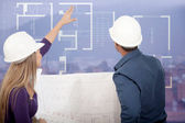 Architects looking at blueprints — Stock Photo