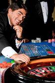 Man in a casino — Stock Photo