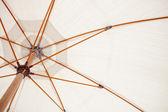 Inside of a white parasol — Stock Photo
