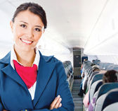 Flight attendant in an airplane — Stock Photo