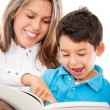 Stock Photo: Mother and son reading a book