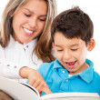 Mother and son reading a book — Stock Photo