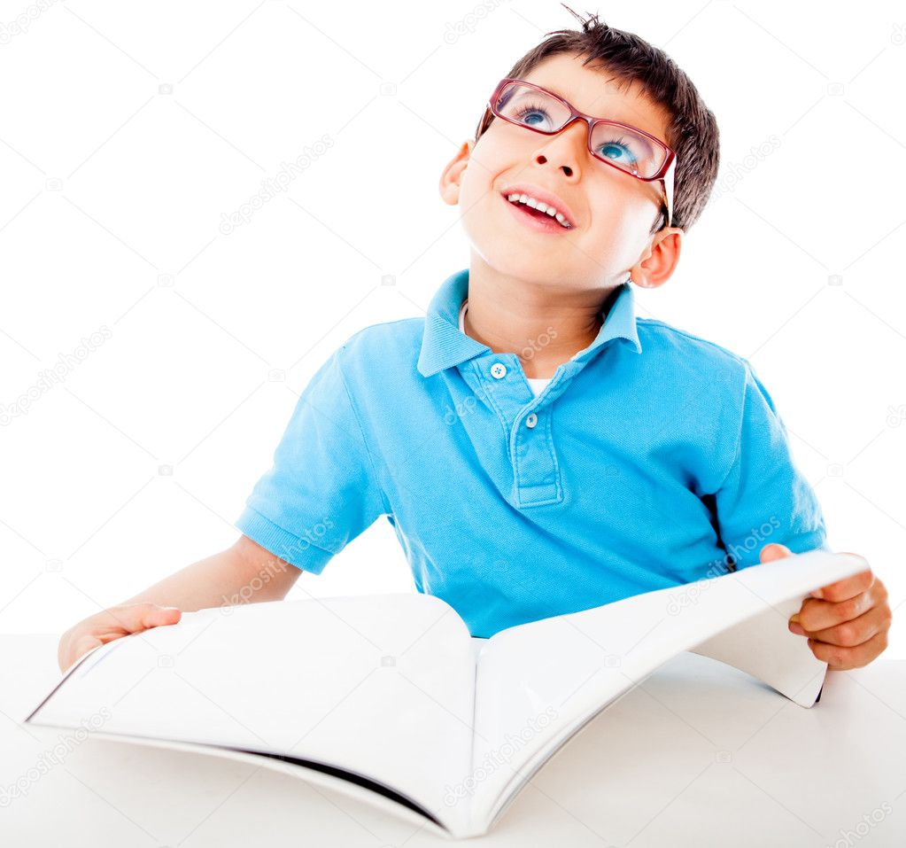 Thoughtful boy fantasizing and reading a book - isolated over white — Stock Photo #10634287