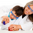 Mother and son playing scientists — Stock Photo