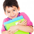 Stock Photo: Boy carrying notebooks