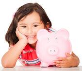 Klein meisje geld te besparen — Stockfoto