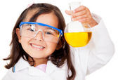 Girl playing at the lab — Stock Photo