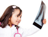 Young doctor lookig at x-ray — Stockfoto