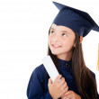 Pensive female graduate — Stock Photo