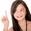 Girl pointing up — Stock Photo
