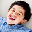 Kid making faces - Stockfoto
