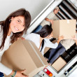 Girls moving house - Stock Photo