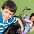 Stock Photo: Kids playing golf