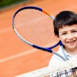Stock Photo: Boy playing tennis