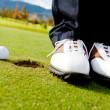 Golf player hitting the ball — Stock Photo