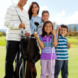Stock Photo: Family playing golf
