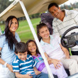 Family in a golf cart - Stock Photo