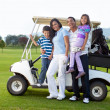 Royalty-Free Stock Photo: Family with a golf cart