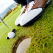 Golf player hitting the ball — Stock Photo