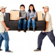 Delivery men carrying a couch - Stock Photo