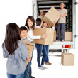 Family loading a truck - Stock Photo