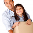 Man moving with his daughter - Stock Photo
